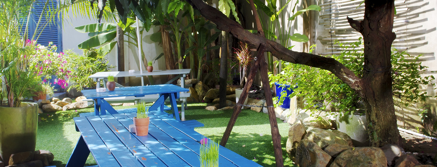 Outdoor seating in lush tropical gardens